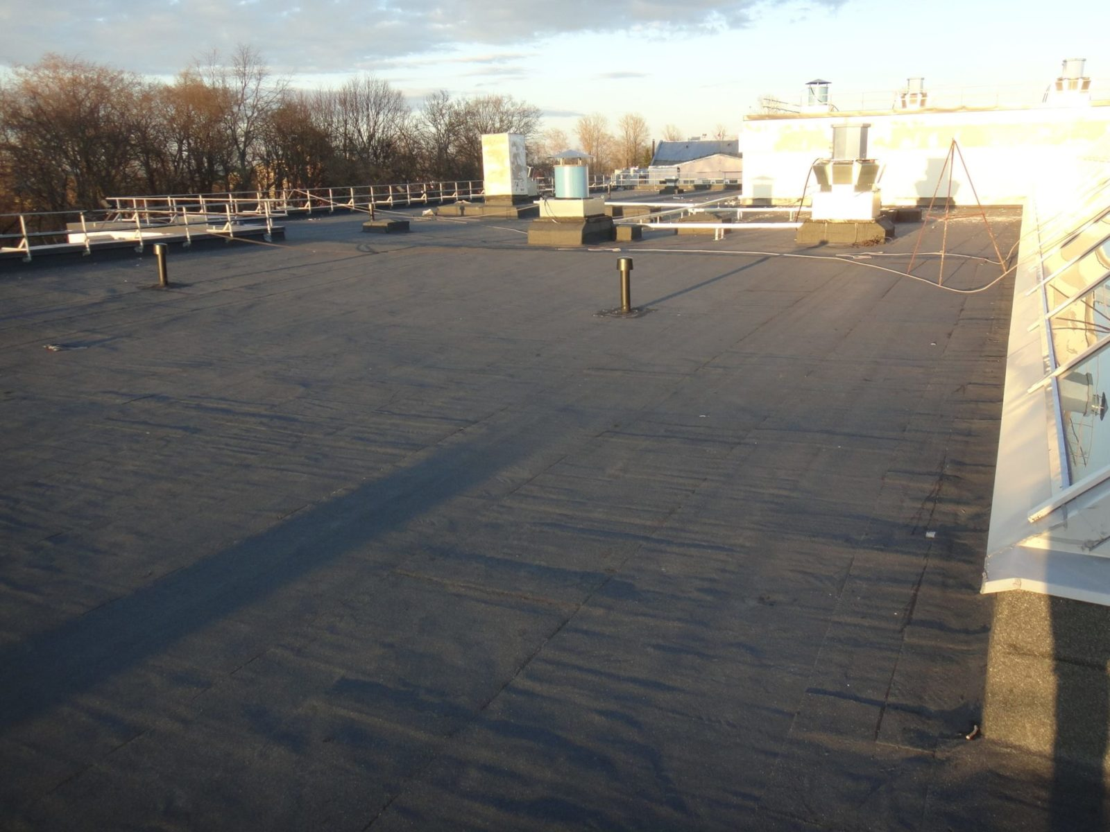 Ремонт существующего кровельного ковра здания в СПб