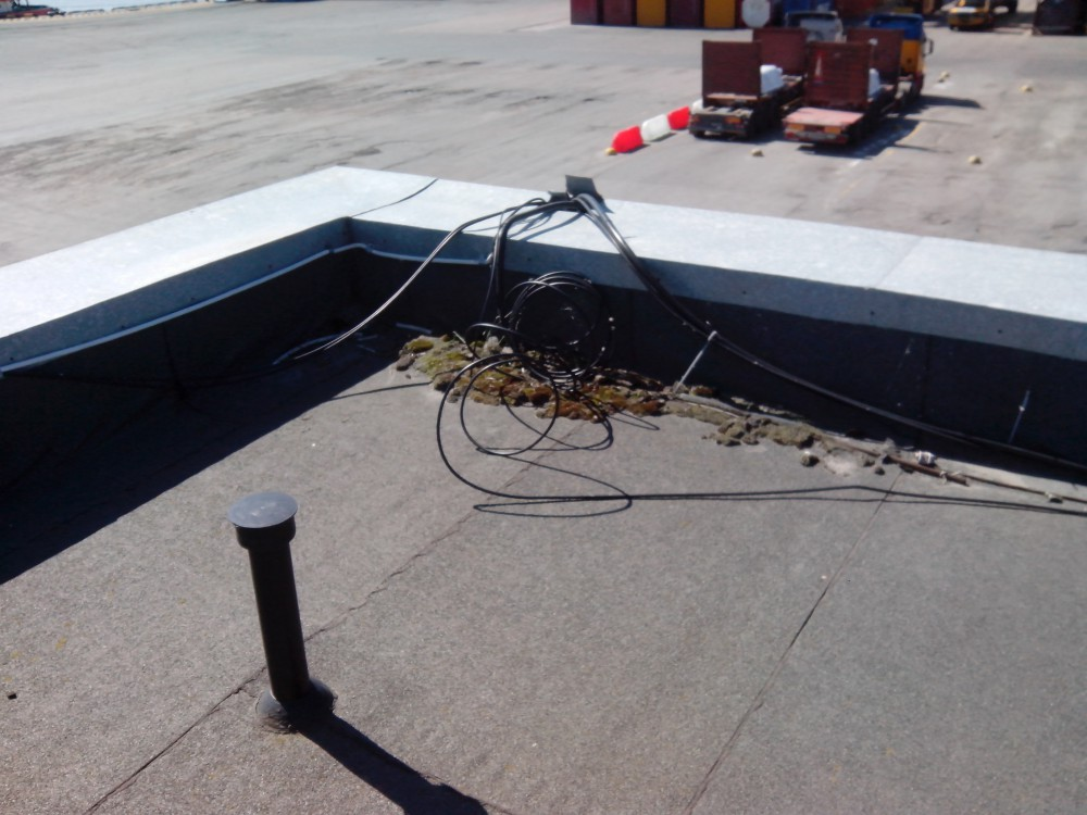 Проведение ремонтных работ наплавляемой кровли офисного здания паромно-перегрузочного комплекса